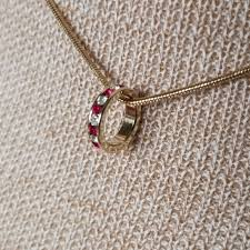 ch gold necklace with red clear