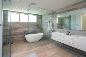 a glass enclosed wet room is a bathroom