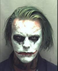 sword carrying man in joker makeup