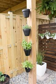 How To Hang Flower Pots Hanging Flower Pots On A Fence Small Garden Design Flower Pots Outdoor Small Backyard