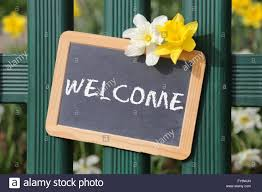 Welcome Sign Garden Flowers Flower Spring With Board On Fence Stock Photo Alamy