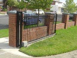 Pin By Amanda Monti On Gates Brick Fence Iron Fence Front Yard Fence