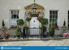Traditional Georgian Property With Hanging Baskets And Plants Stock Image Image Of England Entrance 157179141