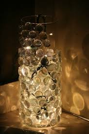hot glue glass pebbles to a vase