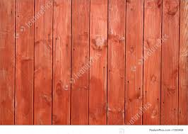 Orange Red Stained Wooden Fence Closeup Image