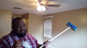 how to clean a popcorn ceiling without