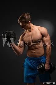 strong bodybuilder with perfect deltoid