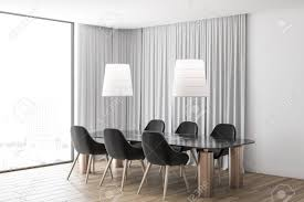 Corner Of Modern Dining Room With White Walls Curtains Near Stock Photo Picture And Royalty Free Image Image 121112481