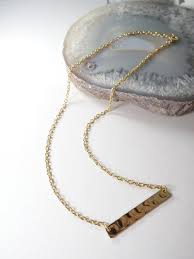 simple gold necklace with textured gold
