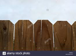Looking Up Over The Top Of A Wooden Stockade Fence Towards The Sky Stock Photo Alamy