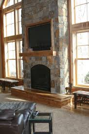 tall stone fireplace rustic family
