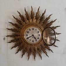 large giltwood sunburst wall clock