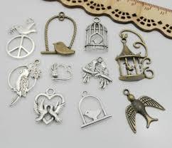 antique bronze silver birdcage pendant