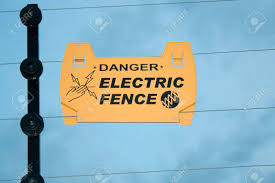 Warning On Electric Fence To Prevent Electric Shock Stock Photo Picture And Royalty Free Image Image 4824249