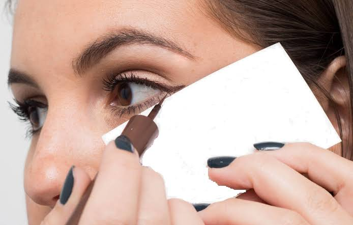 Image result for eyeliner trick: Use a business card to create that perfect wing.