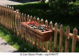 Flowers On Fence Basket Of Fresh Summer Flowers On Wooden Picket Fence