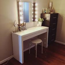 white makeup table with mirror