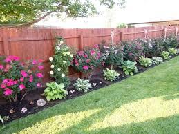 Backyard Landscaping Ideas Yonohomedesign Com In 2020 Privacy Fence Landscaping Fence Landscaping Landscaping Along Fence