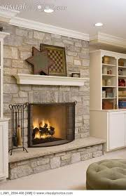 stone fireplace with suspended mantel