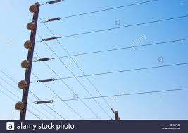 Closeup Of Electric Fence Installation On Boundary Wall Against Blue Stock Photo Alamy
