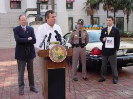 Governor Bush Places Flausa Visit Florida Window Sticker On Highway Patrol Car Florida Department Of Highway Safety And Motor Vehicles