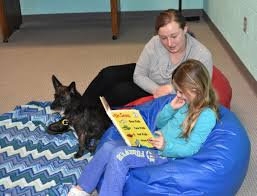 Tail Waggin' Tutors: Students get helping 'paw' in learning to ...