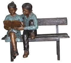 bench reading book bronze statue