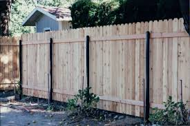 Dog Eared Cedar Wood Fence With Black Square Posts Installed By Frontier Fence Company Wood Fence Cedar Wood Fence Garden City