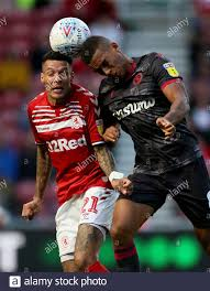 Reading's Andy Rinomhota and Middlesbrough's Marvin Johnson ...