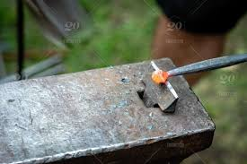 he blacksmith forged a strip of hot