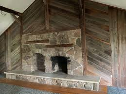 outdated huge stone fireplace and