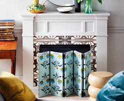 dress the fireplace with designer screens