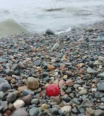 red sea glass marble on the seas