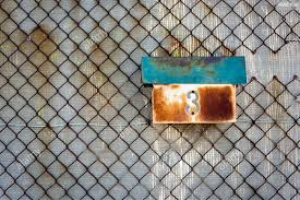 An Old And Rusty Mailbox Attached To A Rusted Chain Link Fence With A Number 3 Stock Photo Alamy