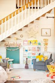 13 Playroom Decor Ideas The Whole Family Can Enjoy Kid Friendly Living Room Living Room Playroom Playroom Layout