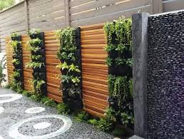 Privacy Fence Ideas Huge Bent Latticework Panels Enclosed In Brick Columns With A Wood Light Beam Ar Vertical Garden Living Wall Planter Vertical Garden Wall