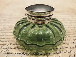 2 antique green glass ink bottles dug