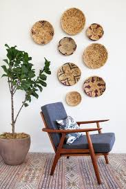 woven baskets and plates as wall decor