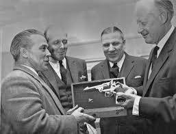 Adrian Stevens being presented with Colt revolver at Bisley