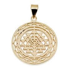 sri yantra in decorated circle pendant