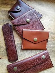 assortment of veg tan leather wallets