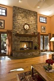 stone fireplace with wood beam mantle