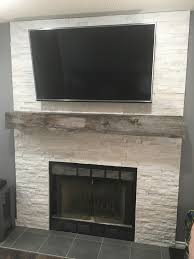 stacked stone fireplace with reclaimed