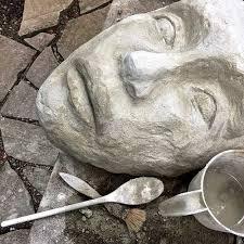 diy concrete face garden sculpture
