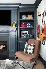 black dentil fireplace mantel with tv
