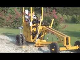 ly powered motor grader tractor
