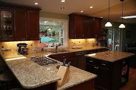 giallo napoli granite dark cabinets