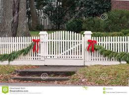 White Picket Fence Garland And Red Bow Iii Stock Photo Image Of Holiday Ribbon 35443656