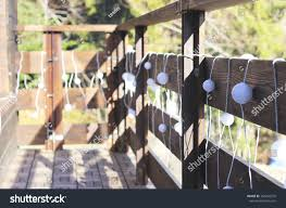 Christmas Decorations On Wooden Fence Outside Stock Photo Edit Now 354242576