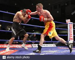 Dave Stewart (Ayr/Wanstead, yellow shorts) defeats Billy Smith ...